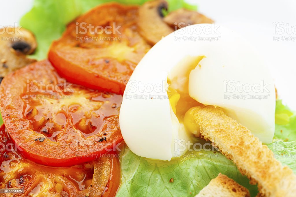Light breakfast with soft egg, tomato and croutons stock photo