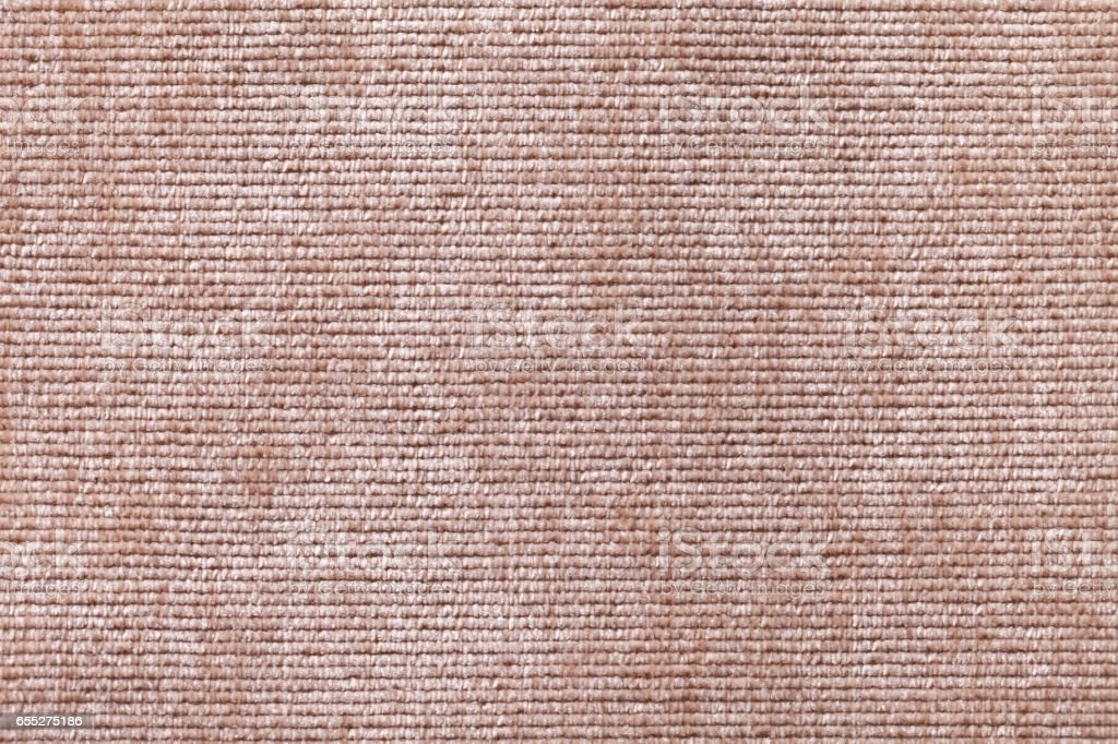 Light brown background from soft textile material. Fabric with natural texture. stock photo