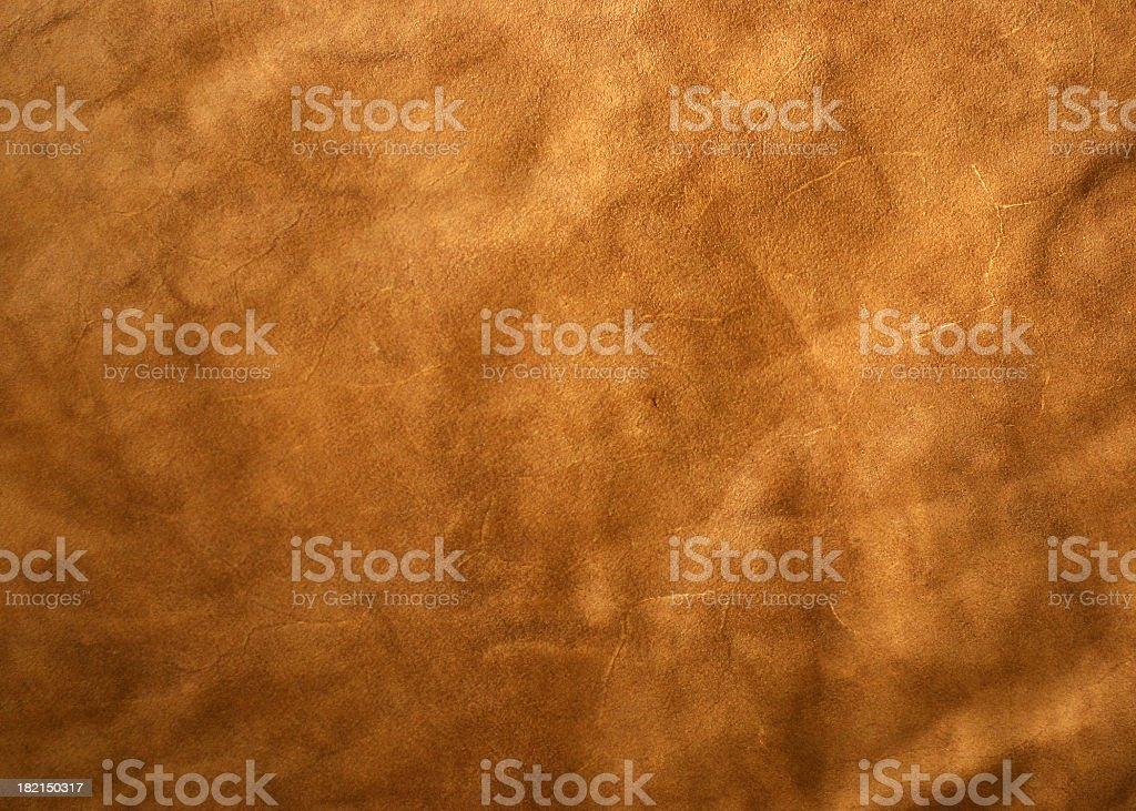 A light brown leather textured background royalty-free stock photo