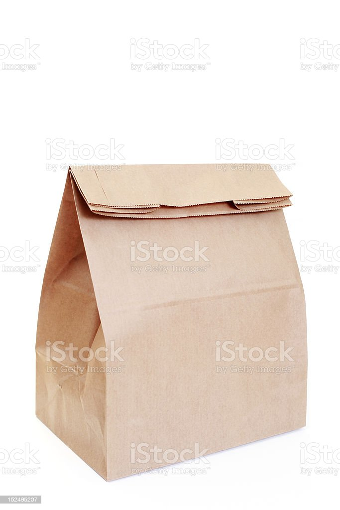 Light brown paper bag in white background royalty-free stock photo