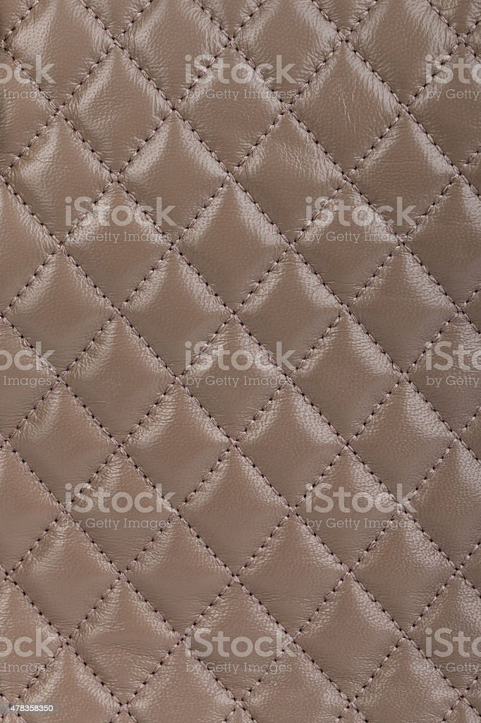 Light brown quilted leather background stock photo