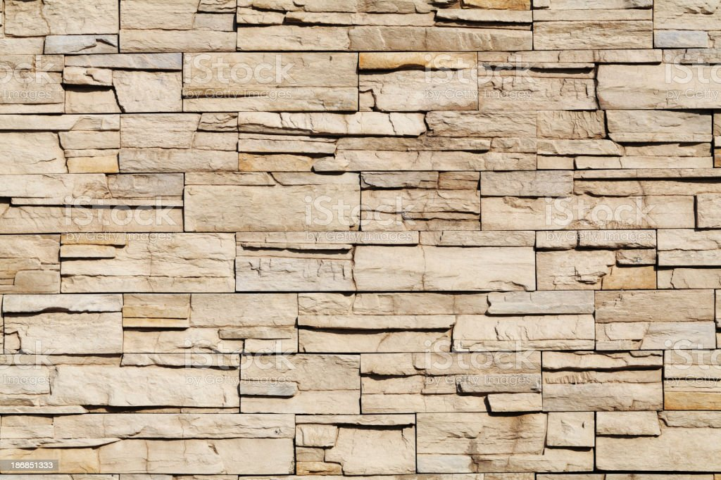Light brown stone wall royalty-free stock photo