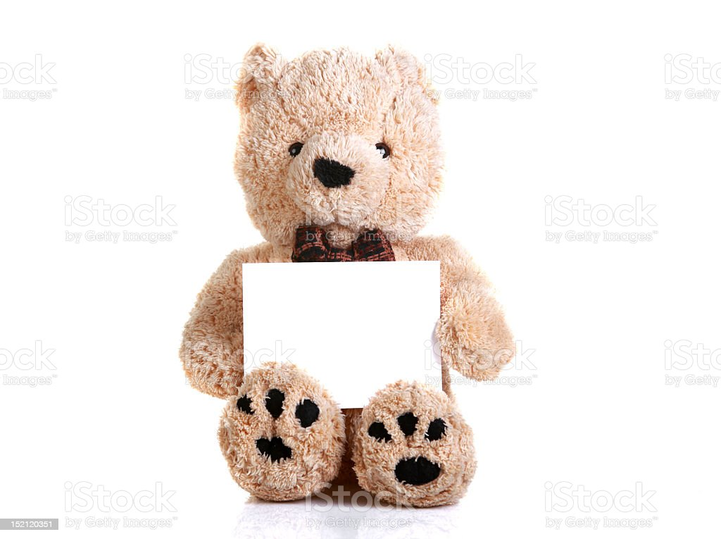 Light brown teddy bear holding a blank white sign on white royalty-free stock photo