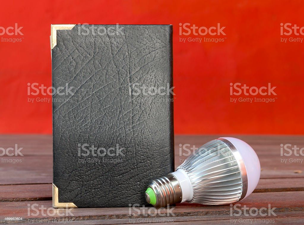 Light bulb and book royalty-free stock photo