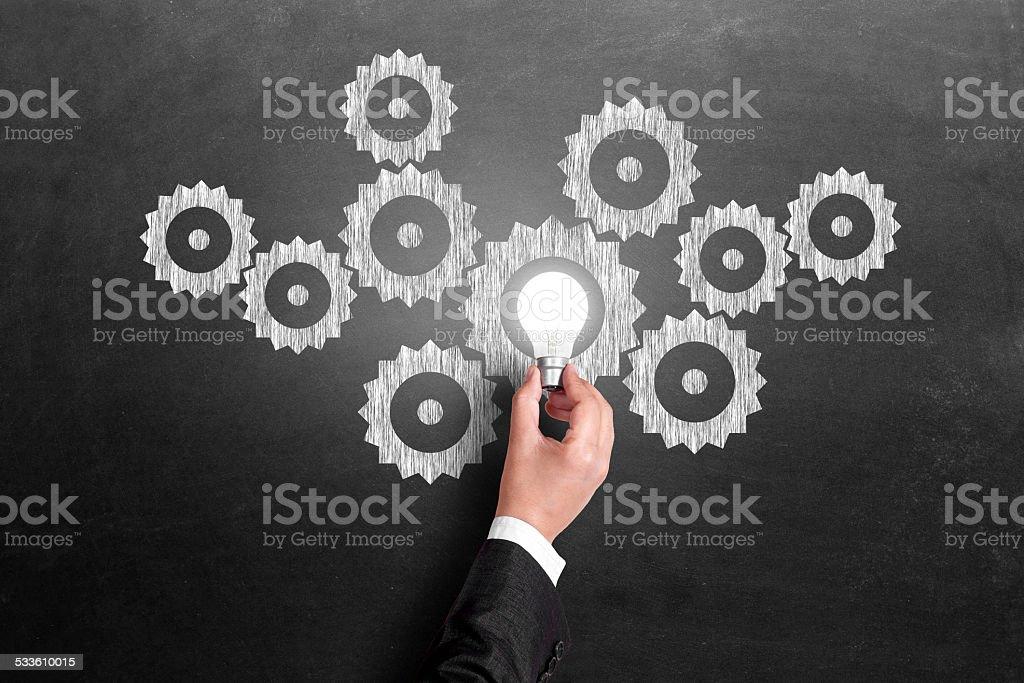 Light bulb conrolling stock photo