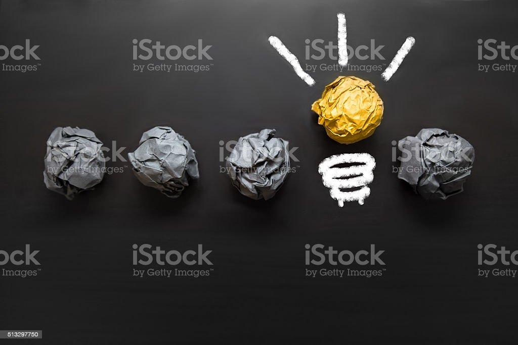 Light bulb crumpled paper on blackboard Concept IDEA Background stock photo
