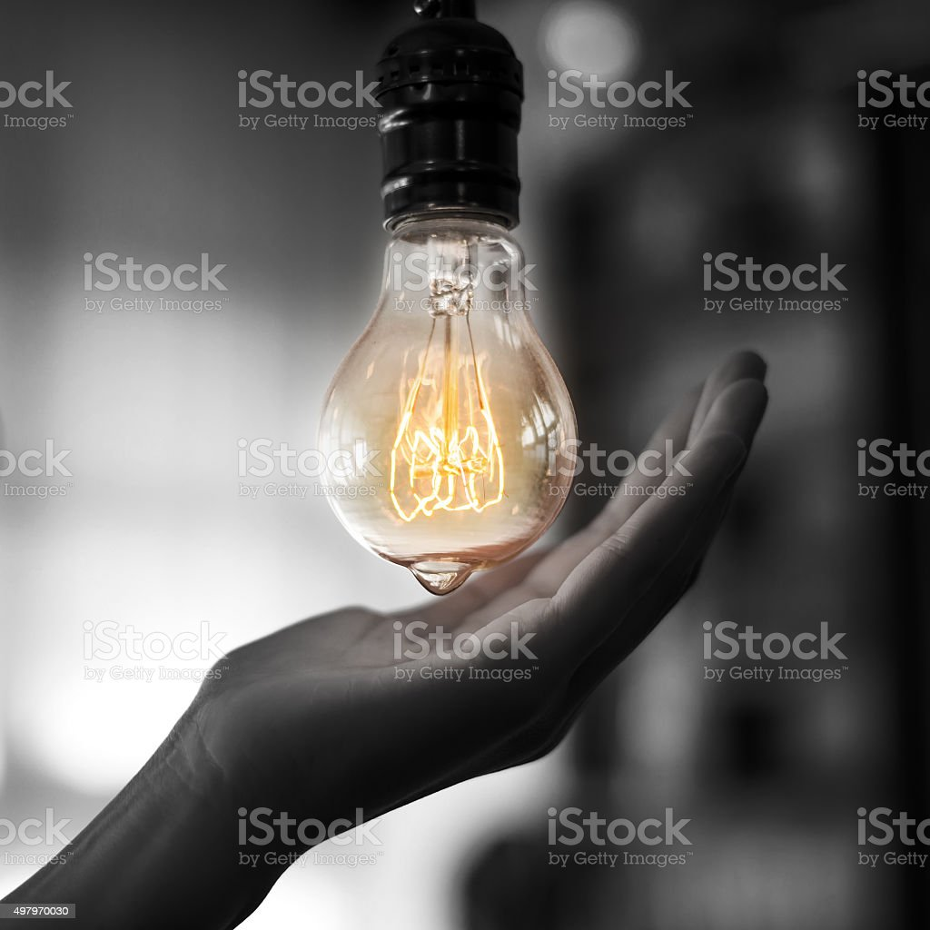 light bulb hold in hand stock photo