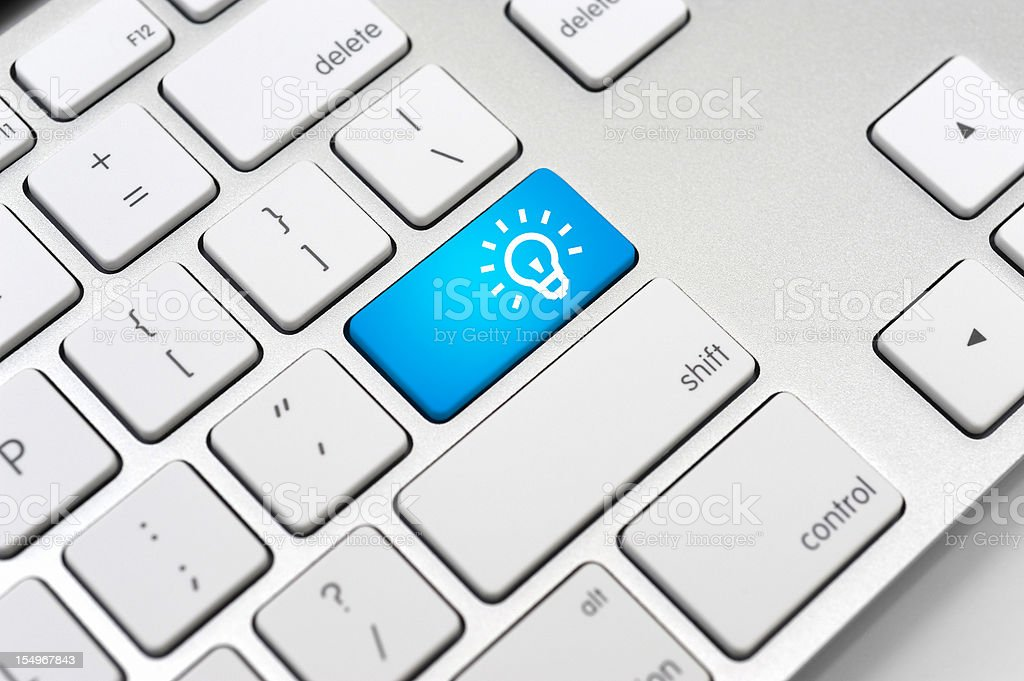 Light Bulb Icon On Computer Keyboard-Energy Saving Concepts and Ideas stock photo
