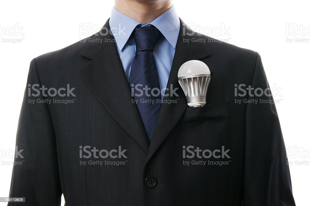 LED light bulb in a jacket pocket royalty-free stock photo