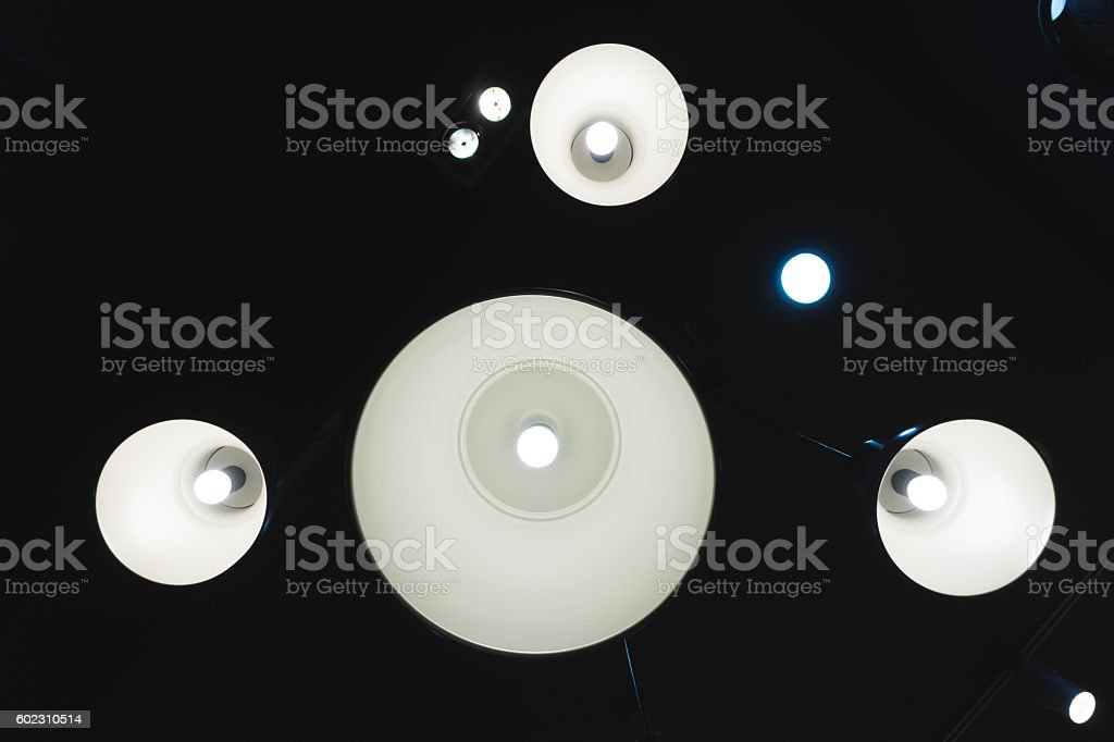 Light bulb in the ceiling stock photo