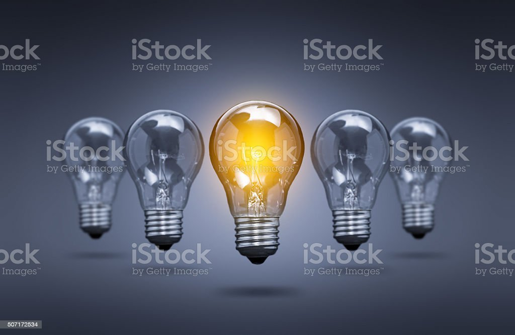 Light bulb lamps on a colour background. stock photo