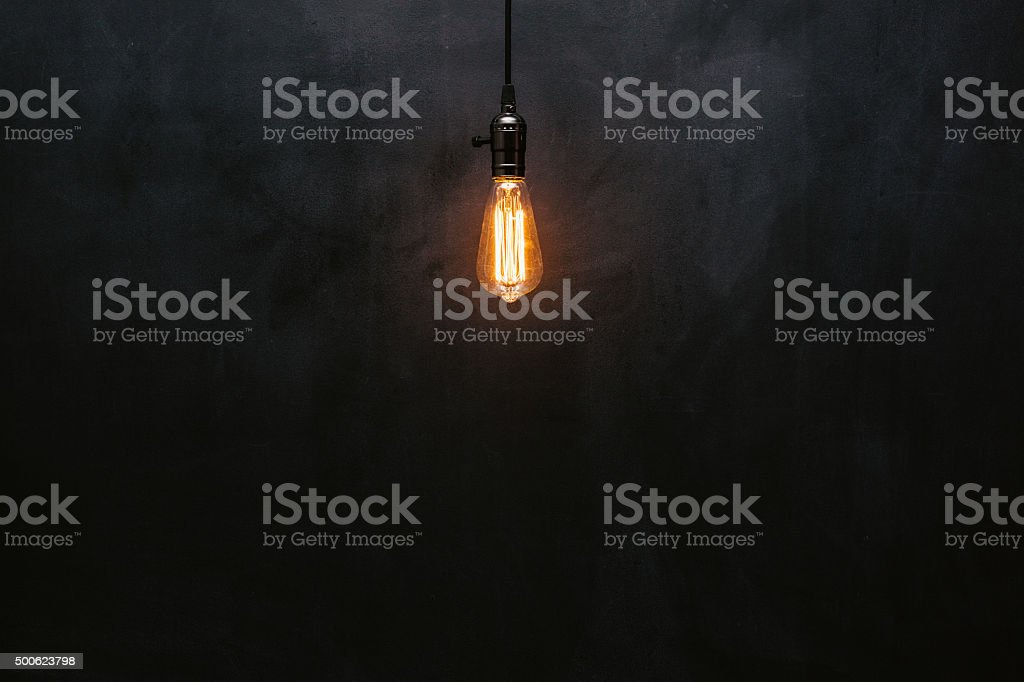 Light bulb on blackboard stock photo