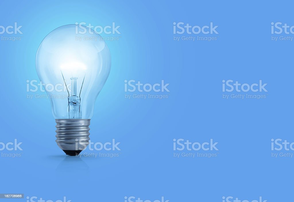 Light Bulb On Blue Background stock photo