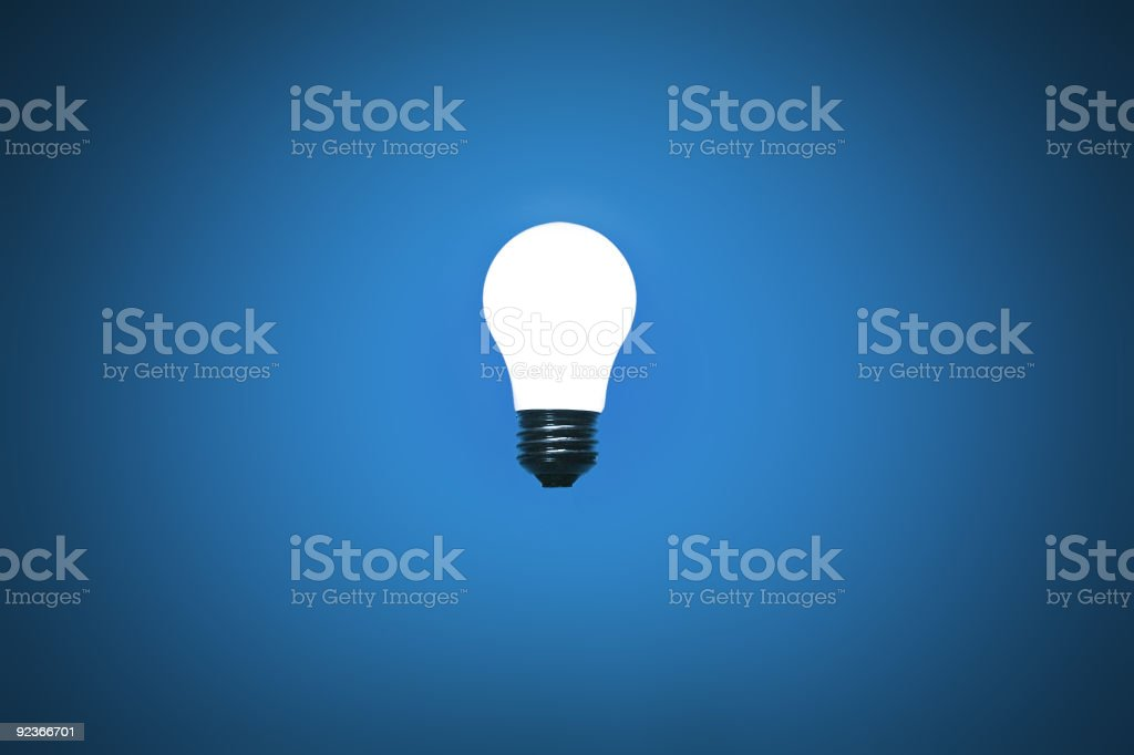 Light Bulb on Blue royalty-free stock photo
