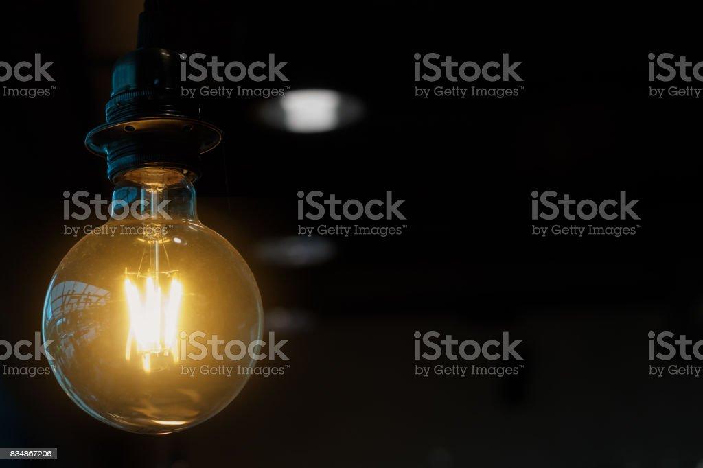 light bulb on dark background stock photo