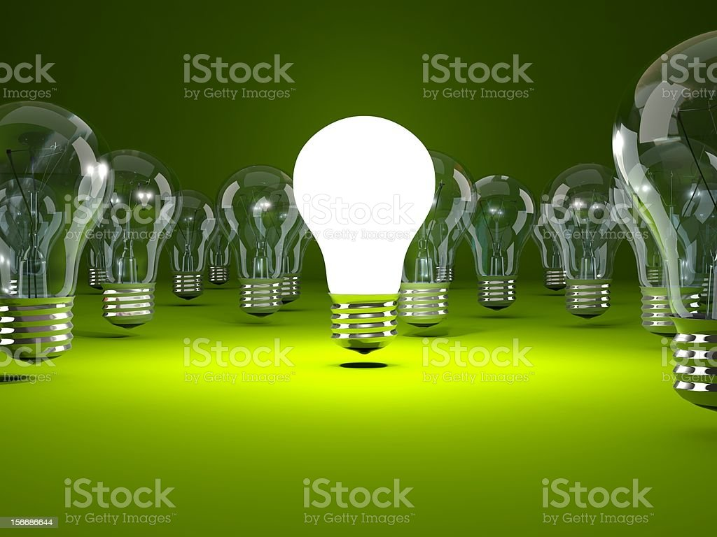 Light bulb on green background royalty-free stock photo