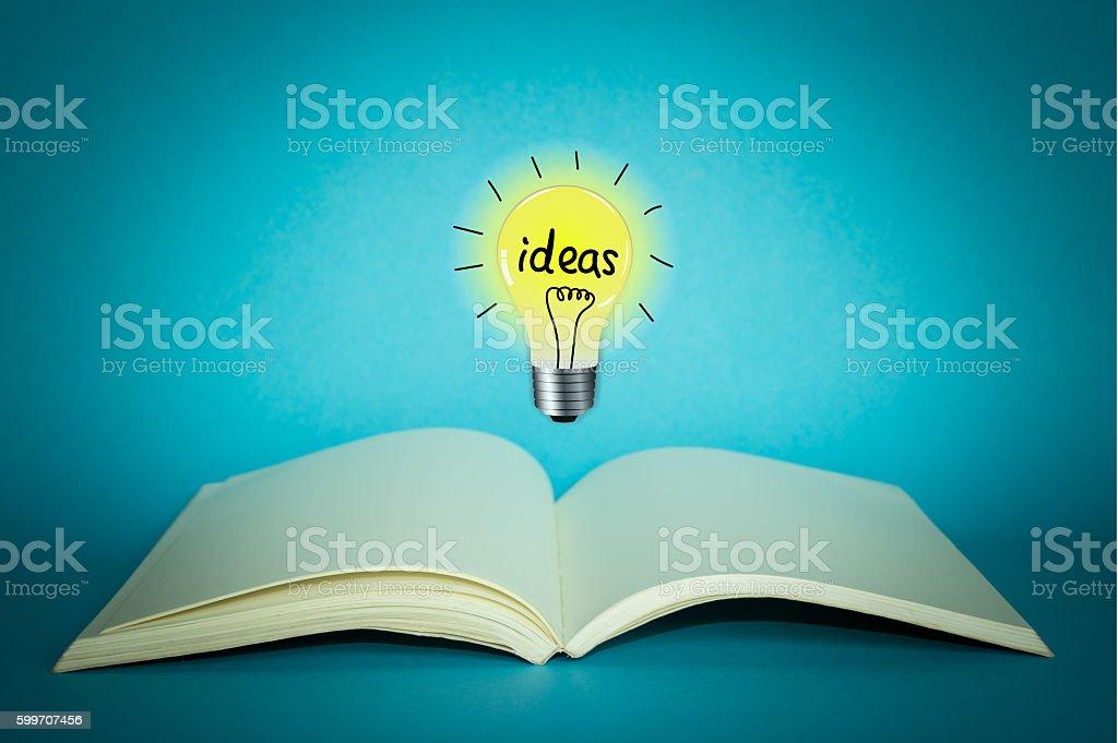 light bulb on notebook for creative ideas concept stock photo