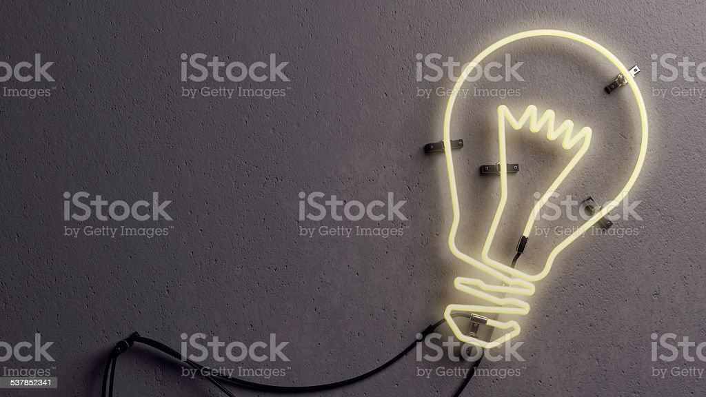 Light bulb shaped neon light stock photo
