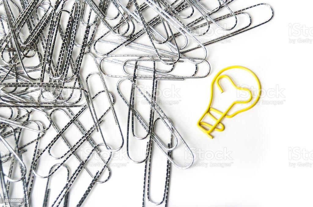 Light bulb shaped paper clip stock photo