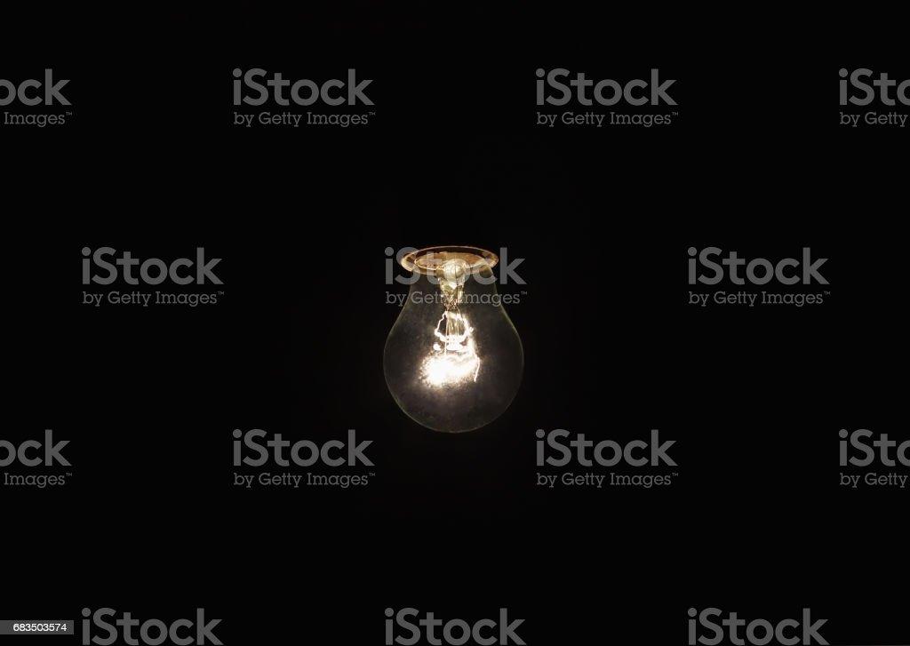 light bulb shines a bright light, soft focus stock photo
