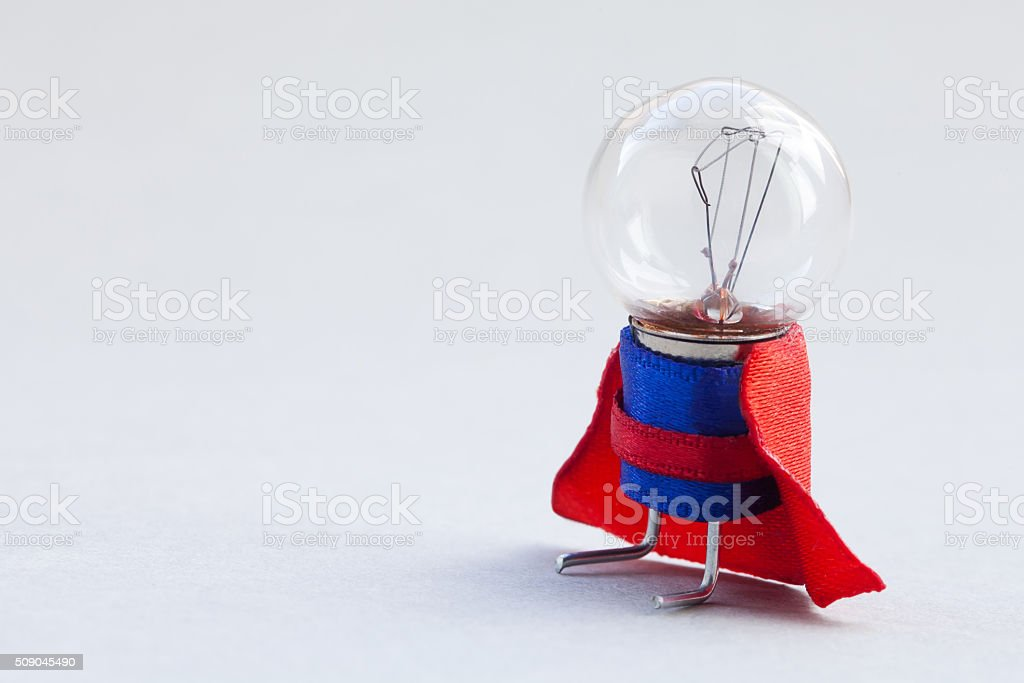 Light bulb super hero dressed in blue suit and red stock photo