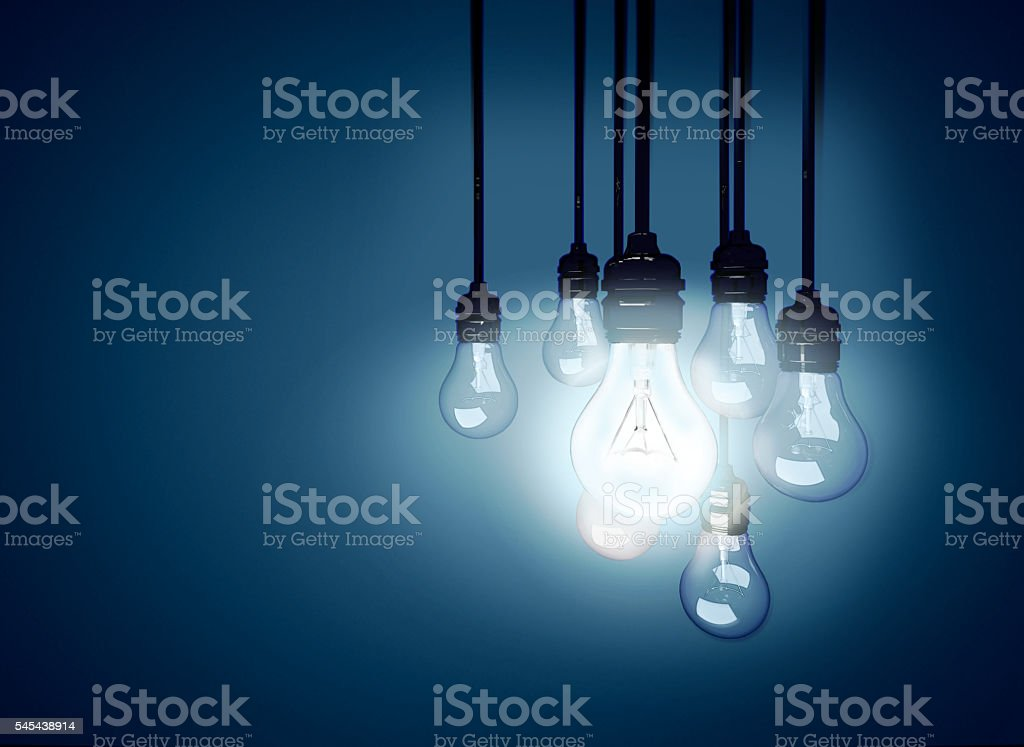 Light bulb that stable and glowing among the others. stock photo