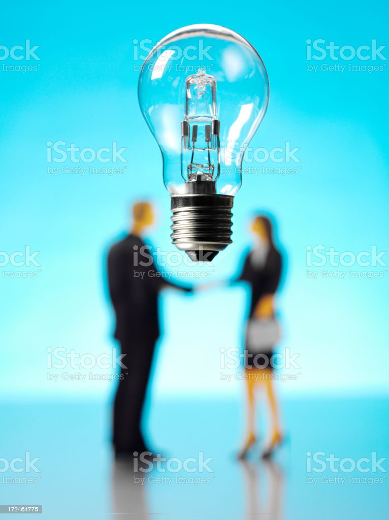 Light Bulb with a Businessman and Women royalty-free stock photo