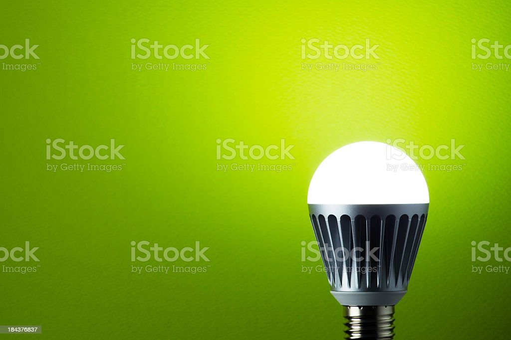 LED light bulb with metal casing royalty-free stock photo