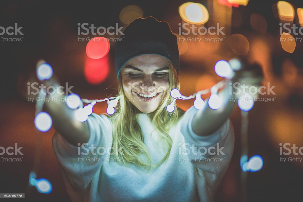 Light bulbs and a girl's smile stock photo