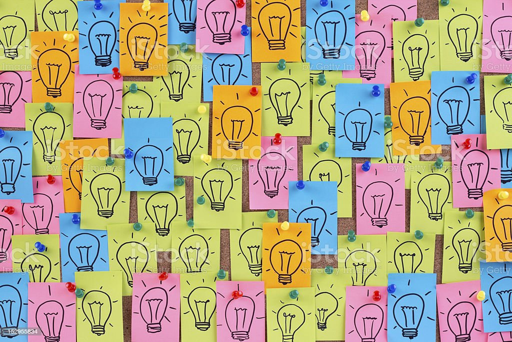 Light bulbs drawn on colorful sticky notes stock photo
