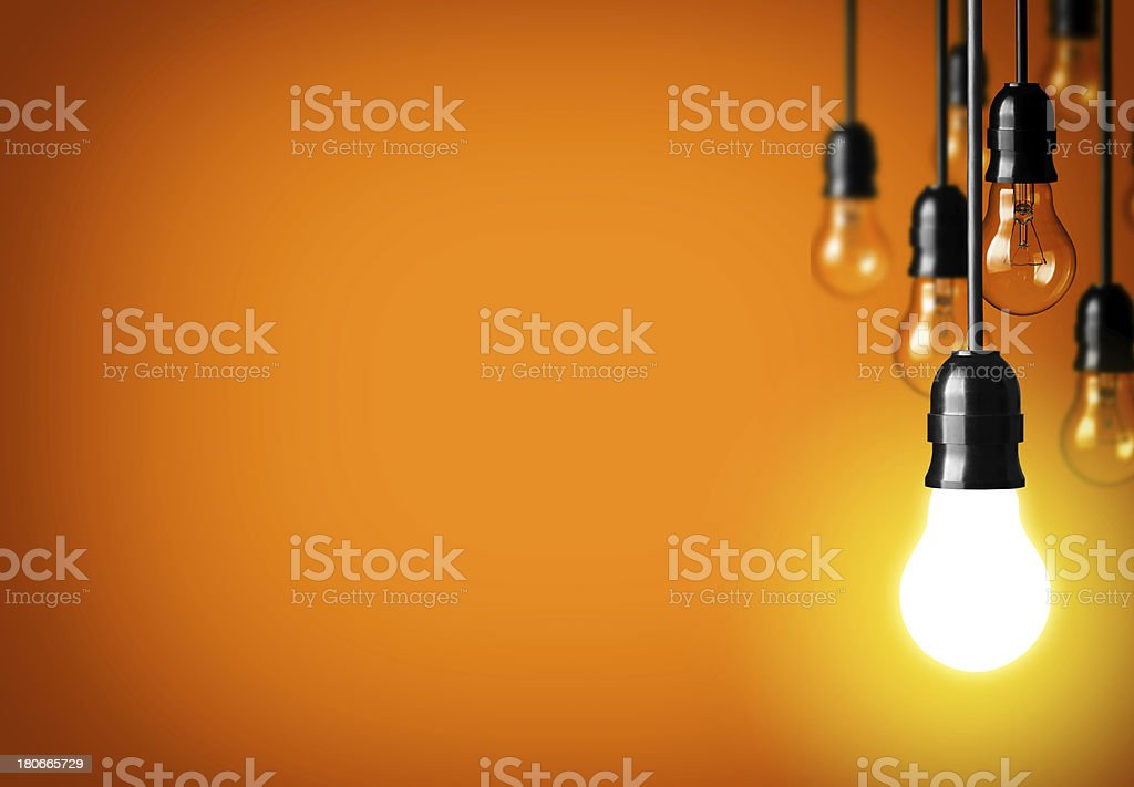 light bulbs hanging against a yellow background stock photo