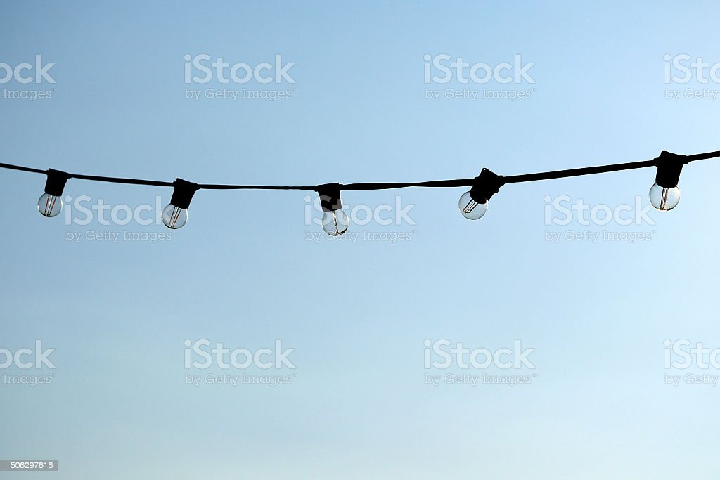 Light bulbs hanging on a wire stock photo