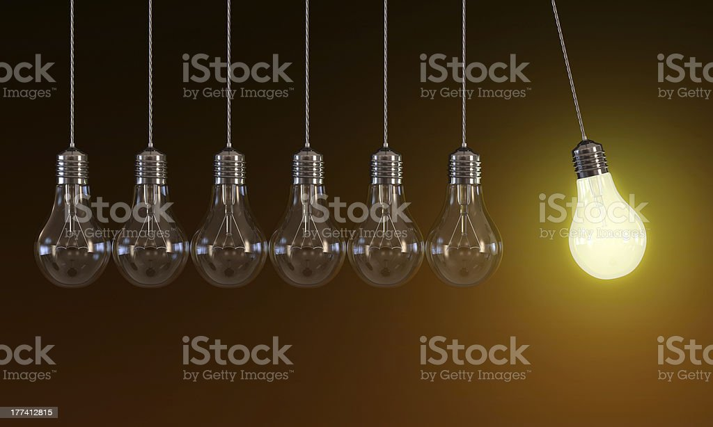 Light bulbs in perpetual motion stock photo