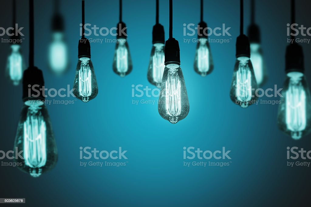 light bulbs on a cool gradient background stock photo