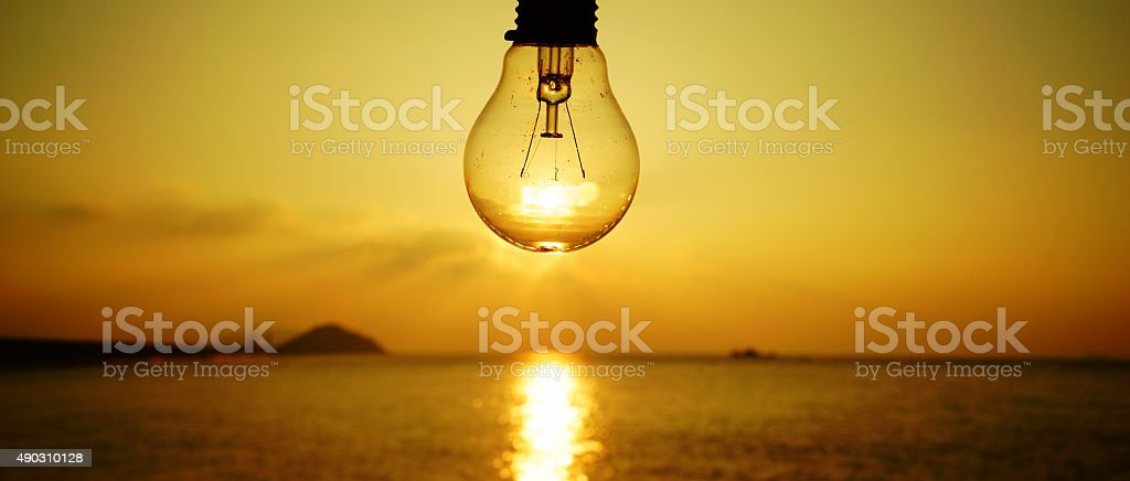Light Bulbs Over Arched Horizon  Clouds and Sky. stock photo