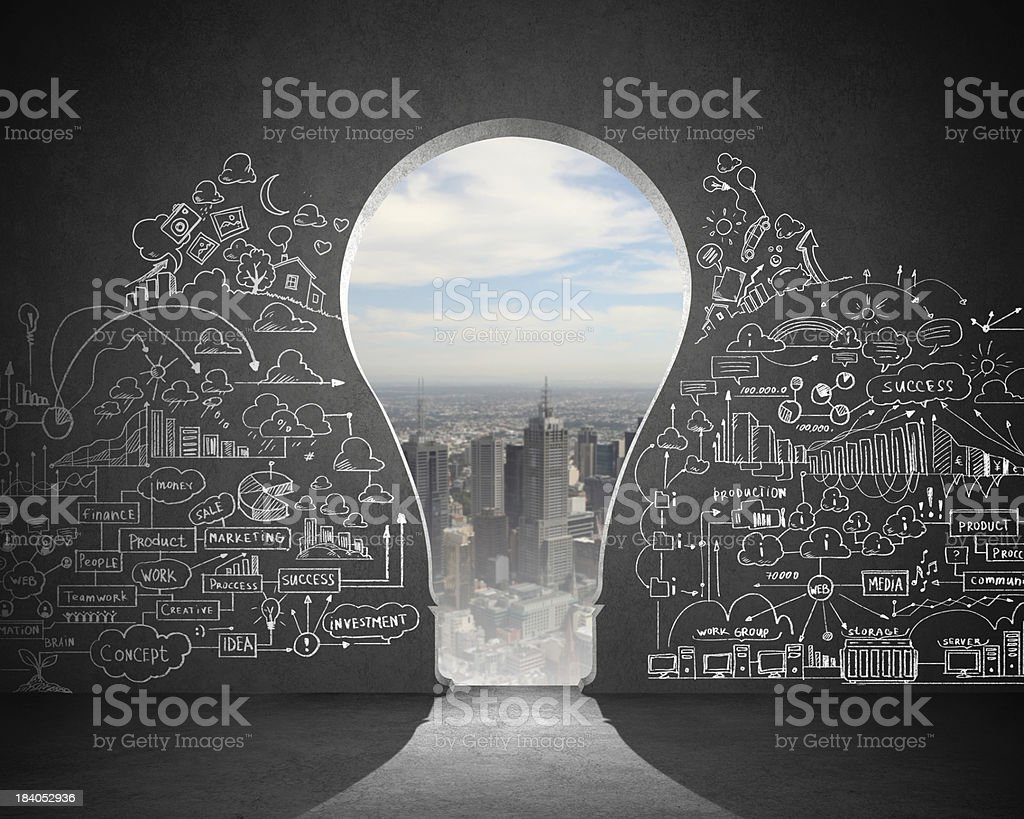 Light bulb-shaped door leading to cities in concept stock photo