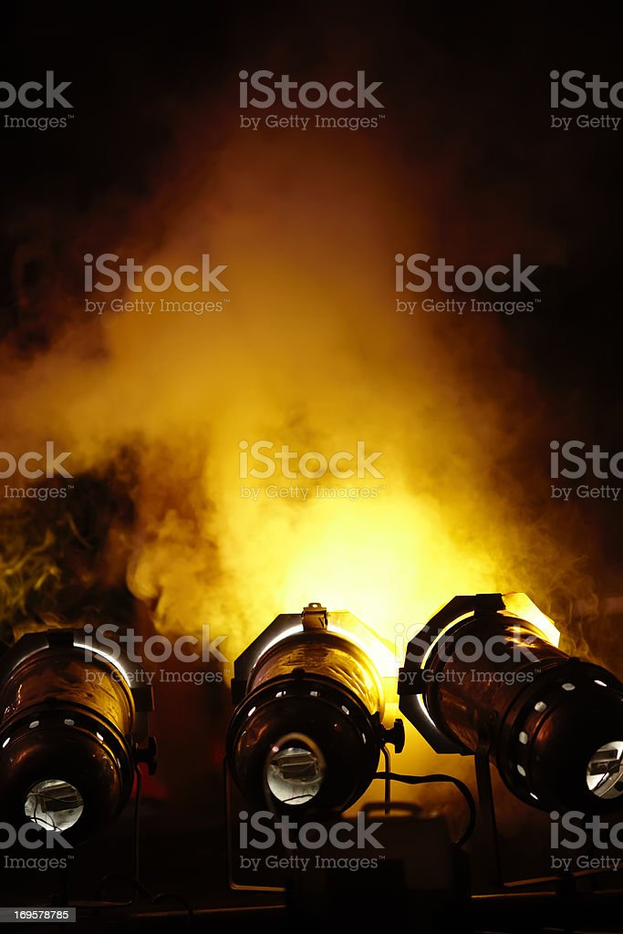 Light canon and smoke at rock consert. Space for text. royalty-free stock photo
