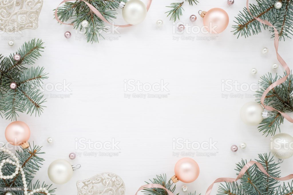 Light Christmas frame, fir, decoration and pearls stock photo