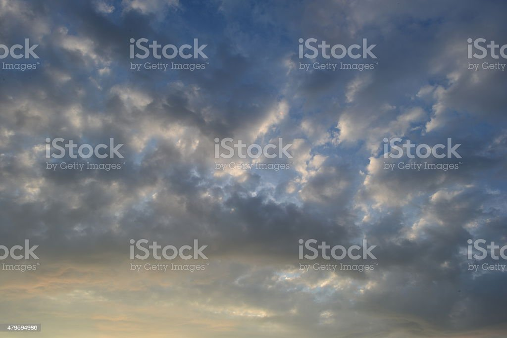 Light cirrus clouds in the bright blue summer sky stock photo