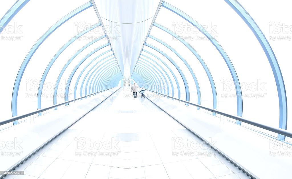 light corridor in airport with curved glass wall, people moving royalty-free stock photo