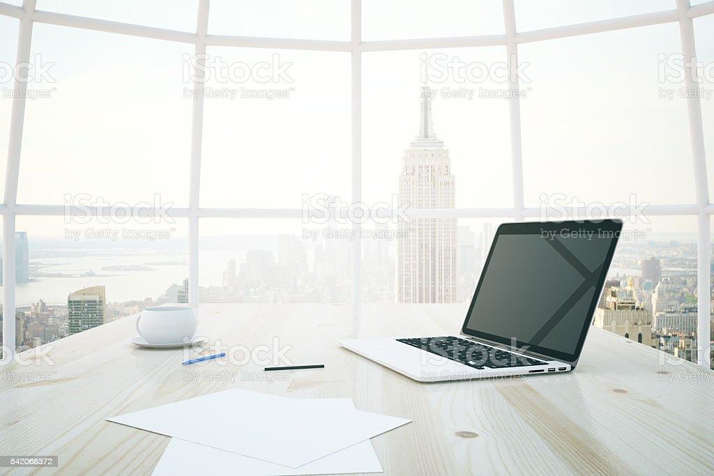 Light desk with laptop stock photo