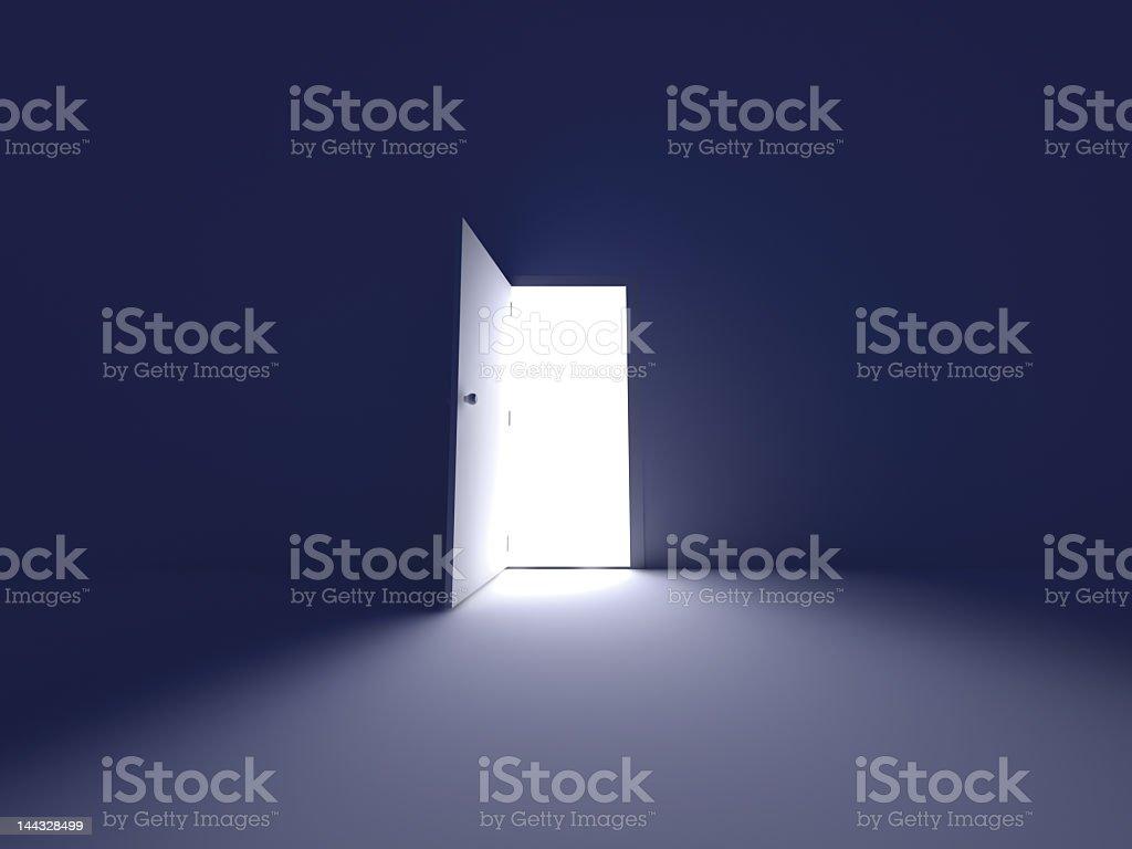 Light emerging from open door in empty room stock photo