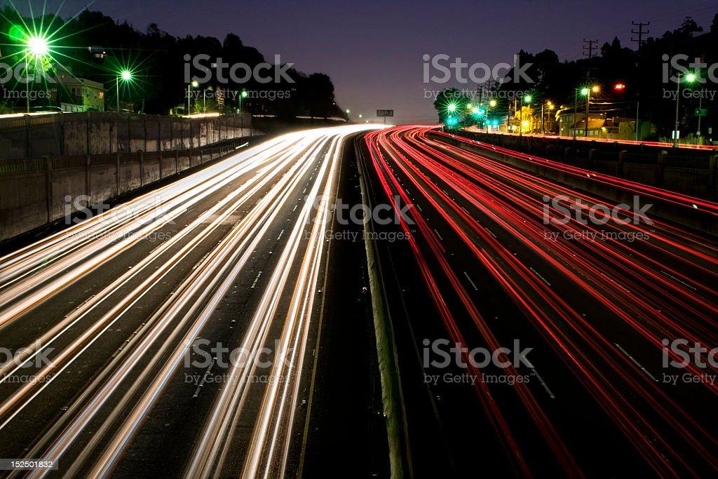 Light exposure of highway traffic at night stock photo