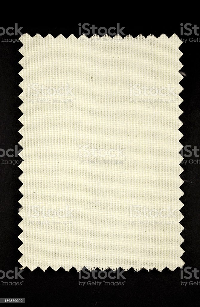 light fabric swatch on black background stock photo