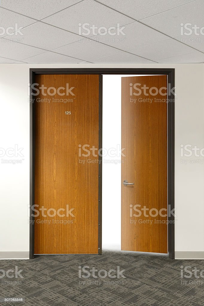Light Filtering Through Open Office Doors stock photo