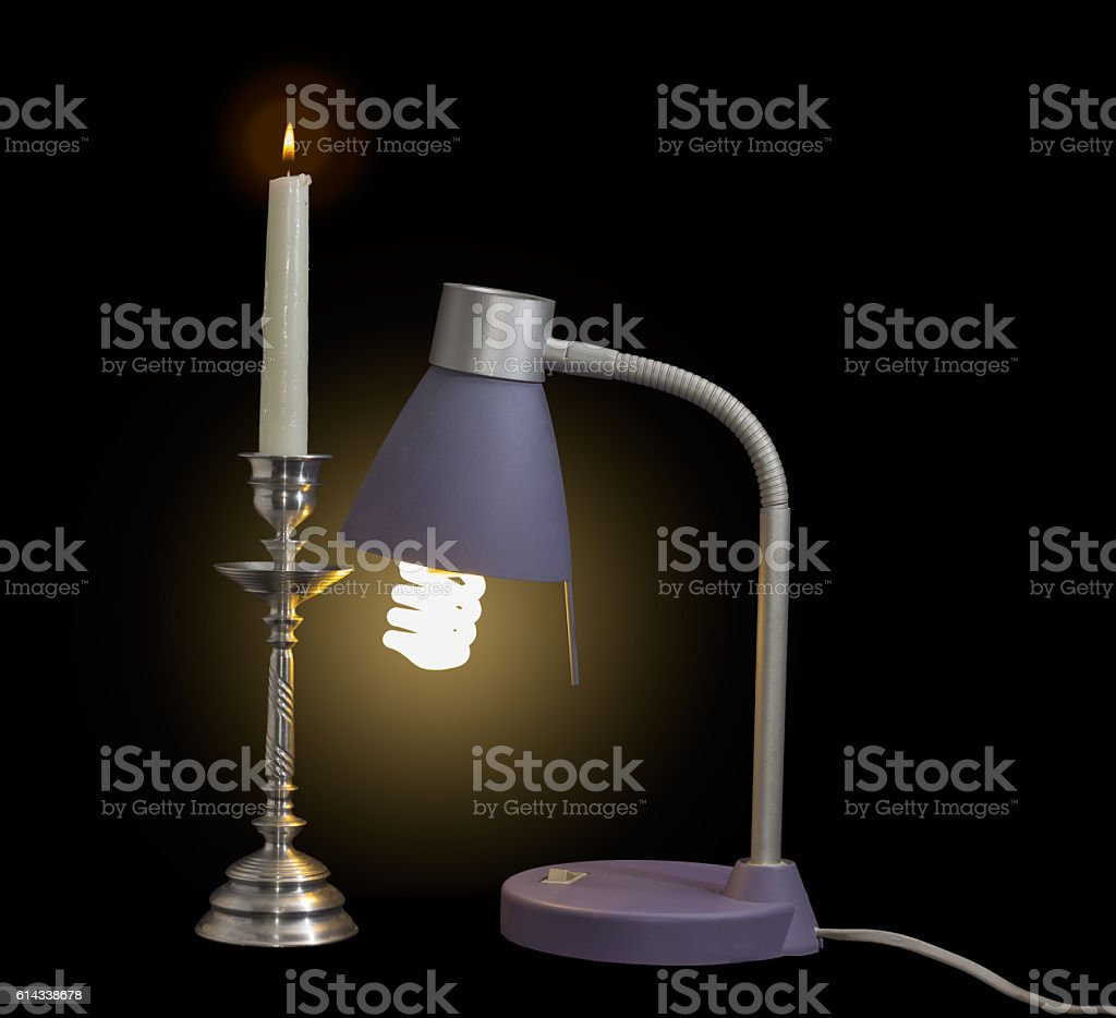 Light fixture with fluorescent lamp and burning candle in candle stock photo