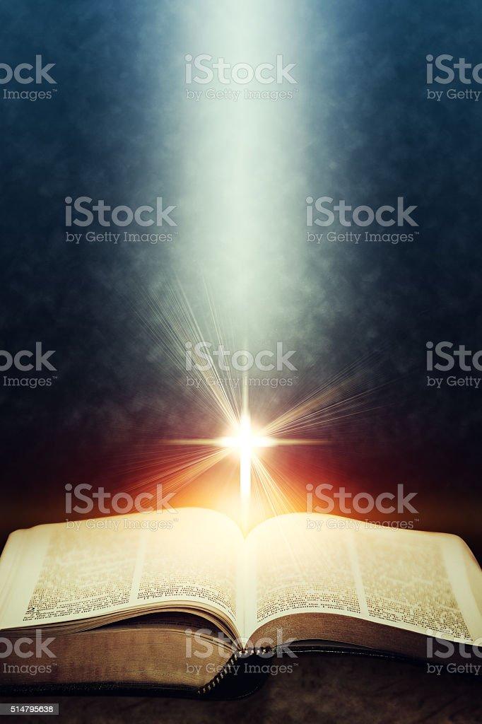 Light flares illuminating the Holy Bible stock photo