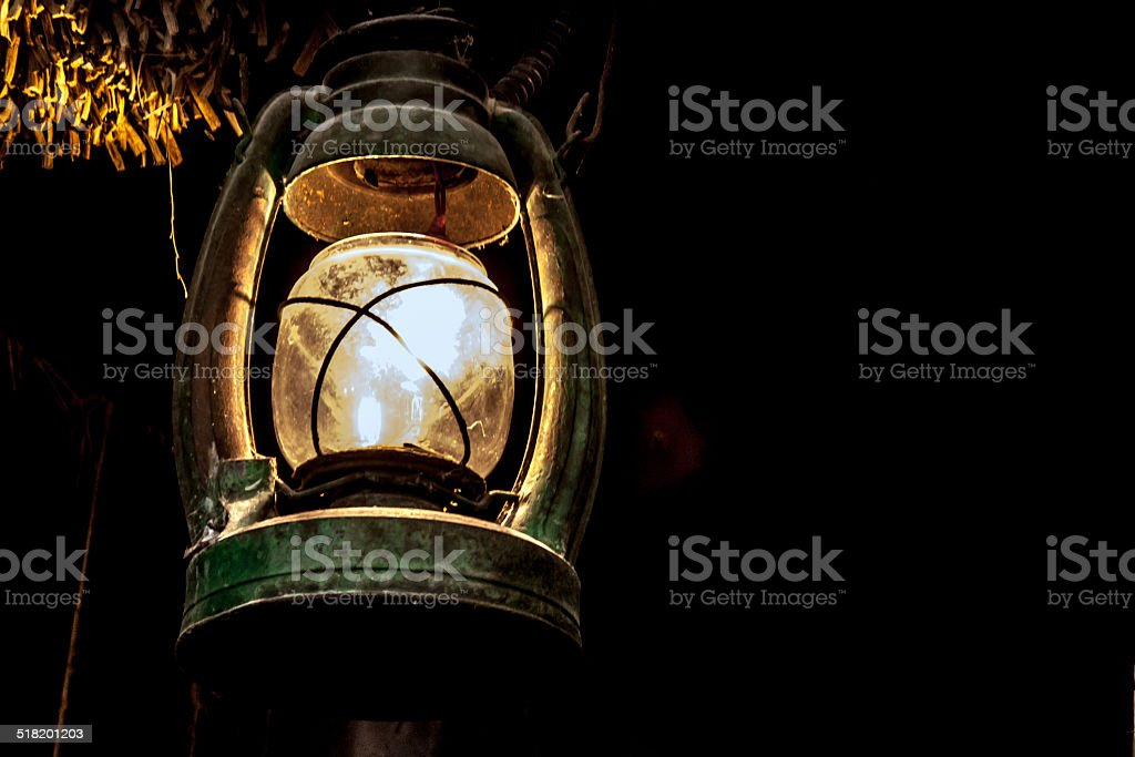 light from vintage lamp on dark stock photo