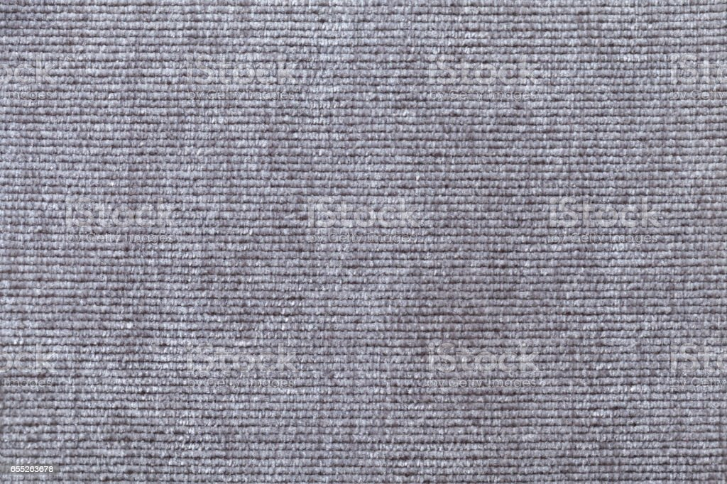 Light gray background from soft textile material. Fabric with natural texture. stock photo