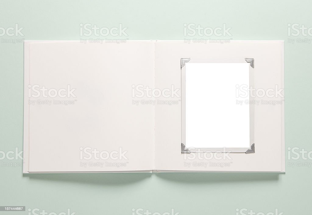 Light green background with a white empty photo album stock photo